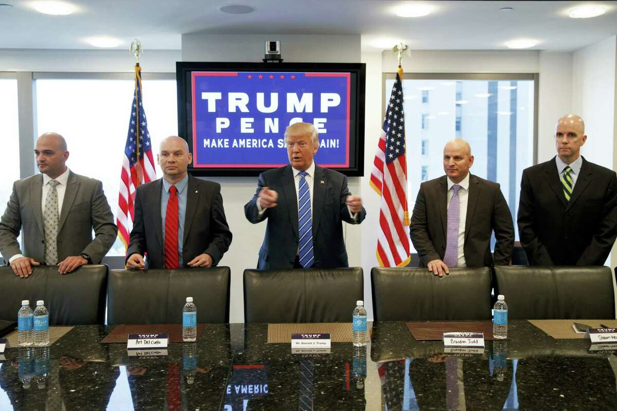 Republican presidential candidate Donald Trump meets with members of the National Border Patrol Council at Trump Tower, Friday, Oct. 7, 2016, in New York.