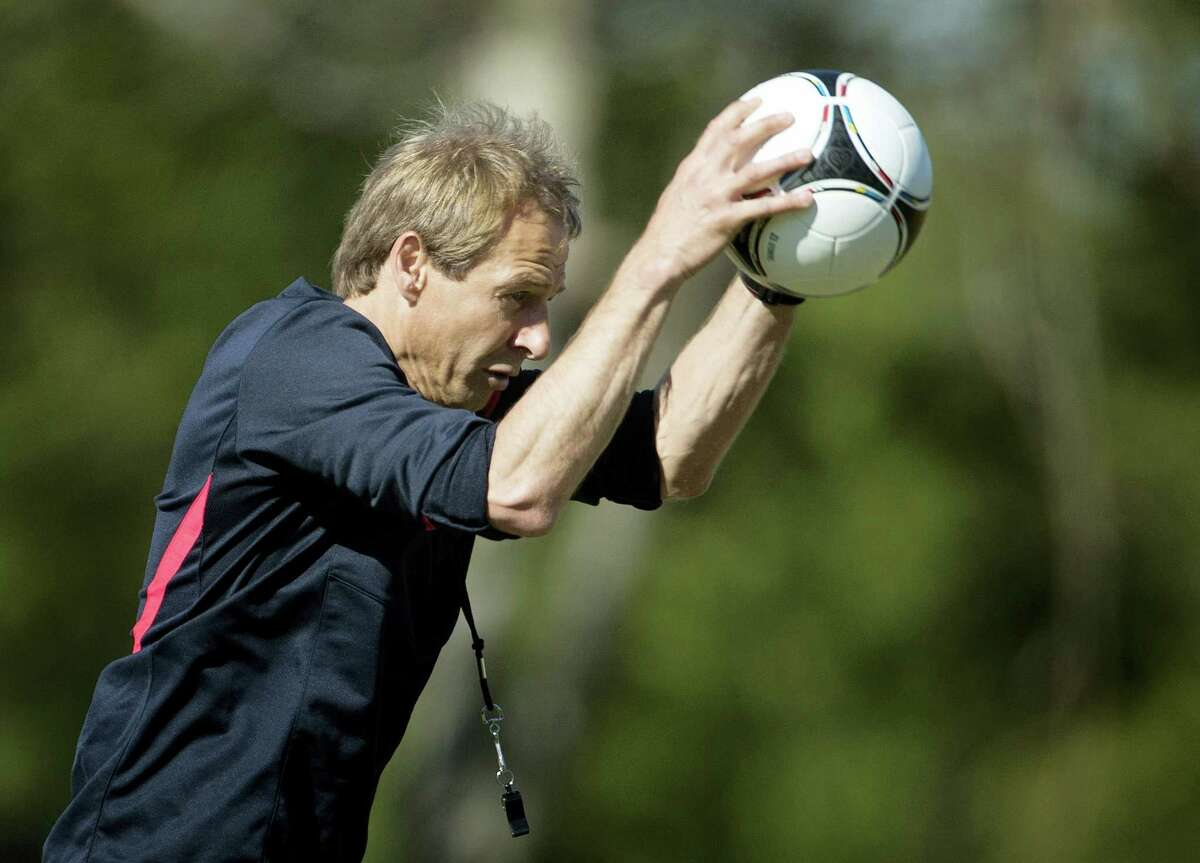 US coach Jurgen Klinsmann slams the ball to the ground during a practice at the FIU Soccer Stadium in Miami.