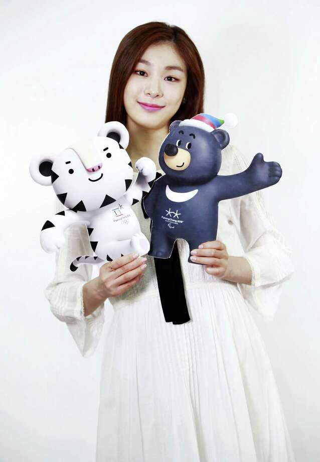 In this photo provided by the PyeongChang Organizing Committee for the 2018 Olympic & Paralympic Winter Games, a former South Korean Olympic figure skater Yuna Kim who is an honorary ambassador for the 2018 Winter Olympics, holds the cut-outs of the official mascots for the 2018 PyeongChang Olympics, named Soohorang, left, and Paralympic Winter Games, named Bandabi, right, in Seoul, South Korea on Thursday. Photo: The Associated Press  / PyeongChang Organizing Committee for the 2018 Olympic & Paralympic Winter Games