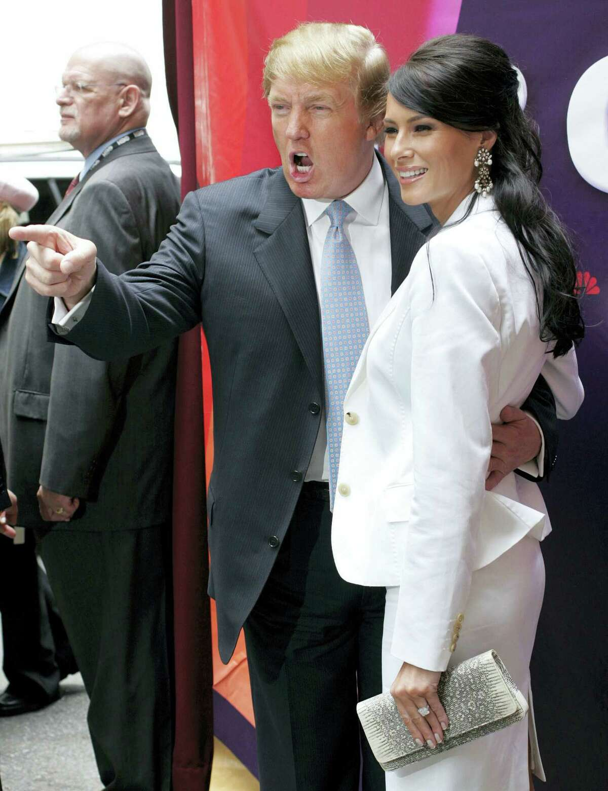 "In this Monday, May 17, 2004, file photo, Donald Trump, center, star of the television show ""The Apprentice,"" and his then fiancee, Melania Knauss, right, arrive for NBC's presentation of its fall season to advertisers at Radio City Music Hall in New York. Randal Pinkett, who won the program in December 2005 and who has recently criticized Trump during his 2016 run for president, said he remembered the real estate mogul talking about which contestants he wanted to sleep with, even though Trump had married Melania, a former model, earlier that year: ""He was like 'Isn't she hot, check her out,' kind of gawking, something to the effect of 'I'd like to hit that.'"""