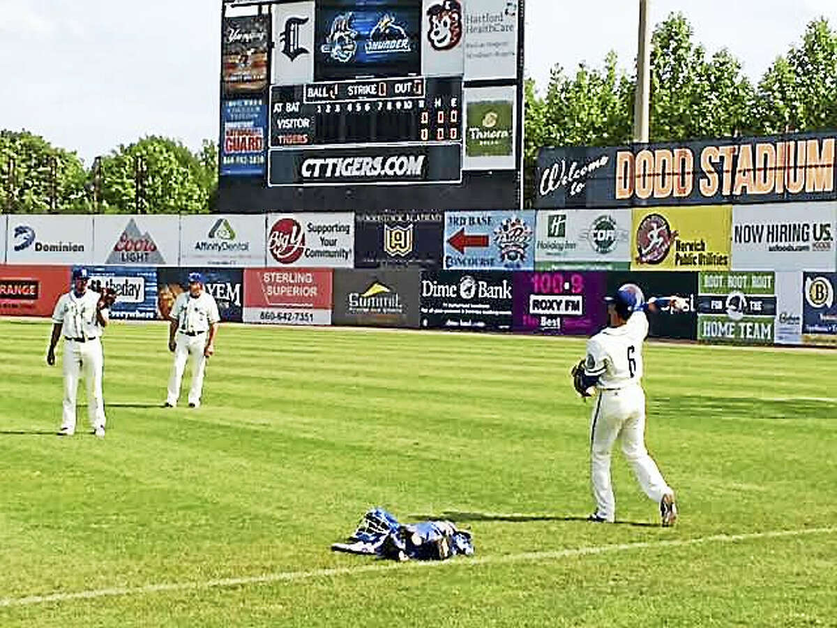 Hartford Yard Goats players warm up before recent game at Norwich's Dodd Stadium.