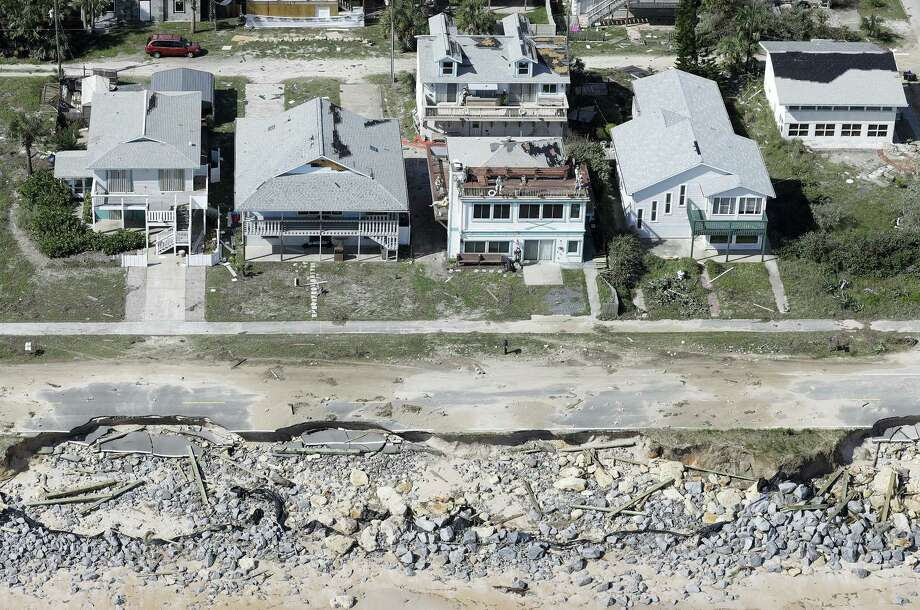 Portions of SR A1A are washed out from Hurricane Matthew on Saturday in Flagler Beach, Fla.  The damage from Matthew caused  beach erosion, washed out some roads and knocked out power for more than 1 million customers in several coastal counties. Photo: Chris O'Meara — AP Photo / Copyright 2016 The Associated Press. All rights reserved.