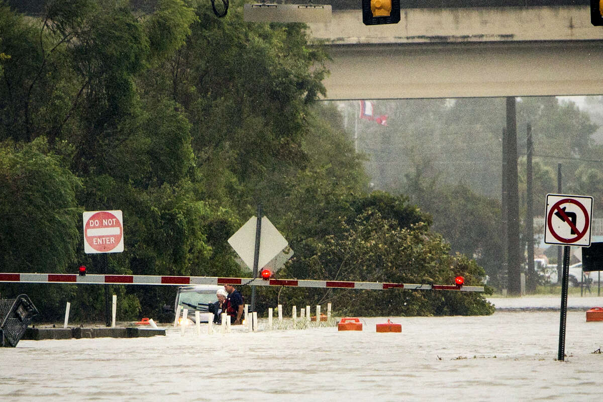 An unidentified woman is rescued from her vehicle which is floating in waist-deep water on flooded President Street after Hurricane Matthew caused flooding along the east coast of Georgia on Saturday in Savannah, Ga.
