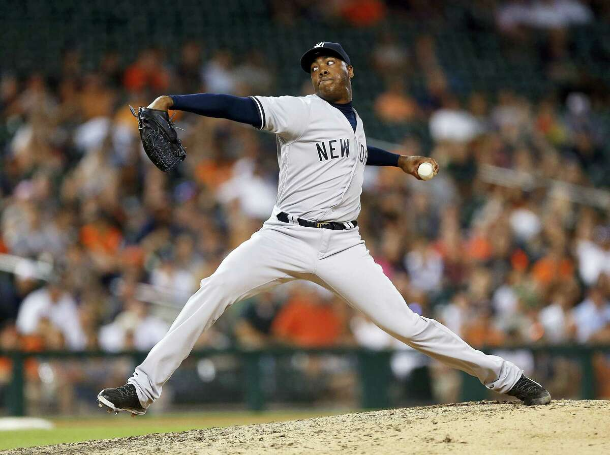 Yankees relief pitcher Aroldis Chapman throws against the Tigers during the ninth inning on Thursday.