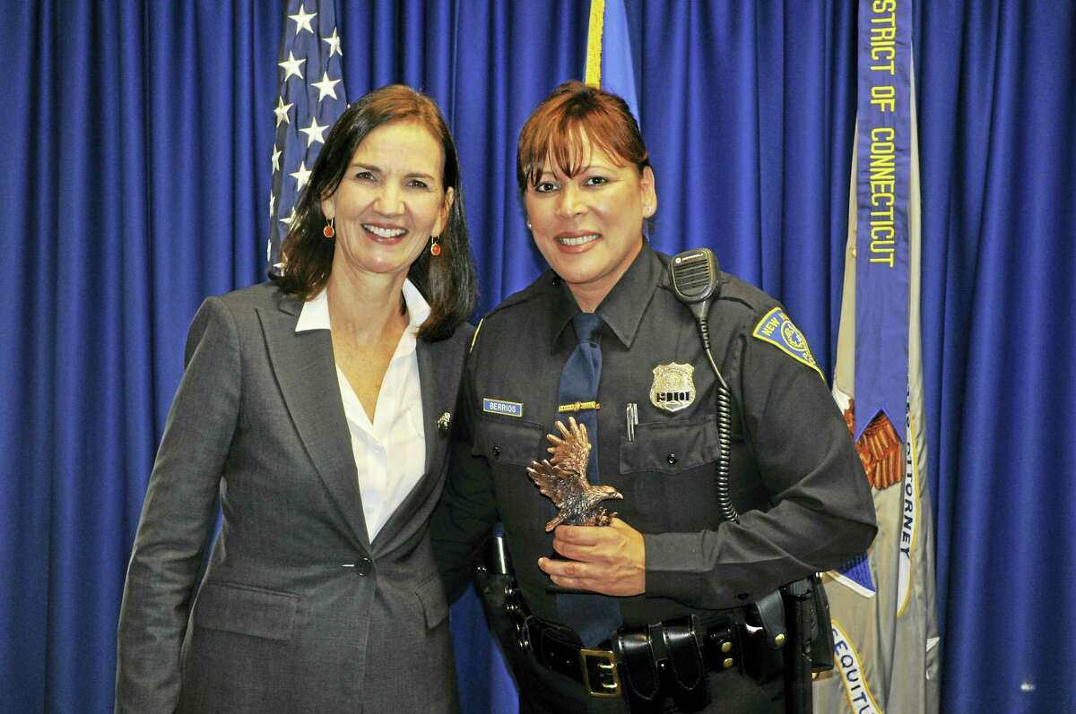 U.S. Attorney Deirdre M. Daly and New Haven Police Department Officer Elsa Berrios