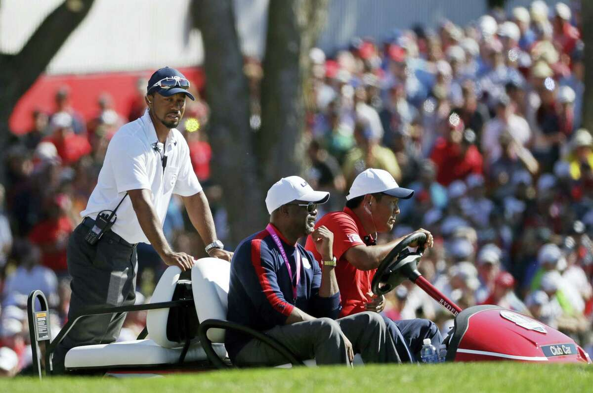 Tiger Woods watches from the first hole during a singles match at the Ryder Cup last week.