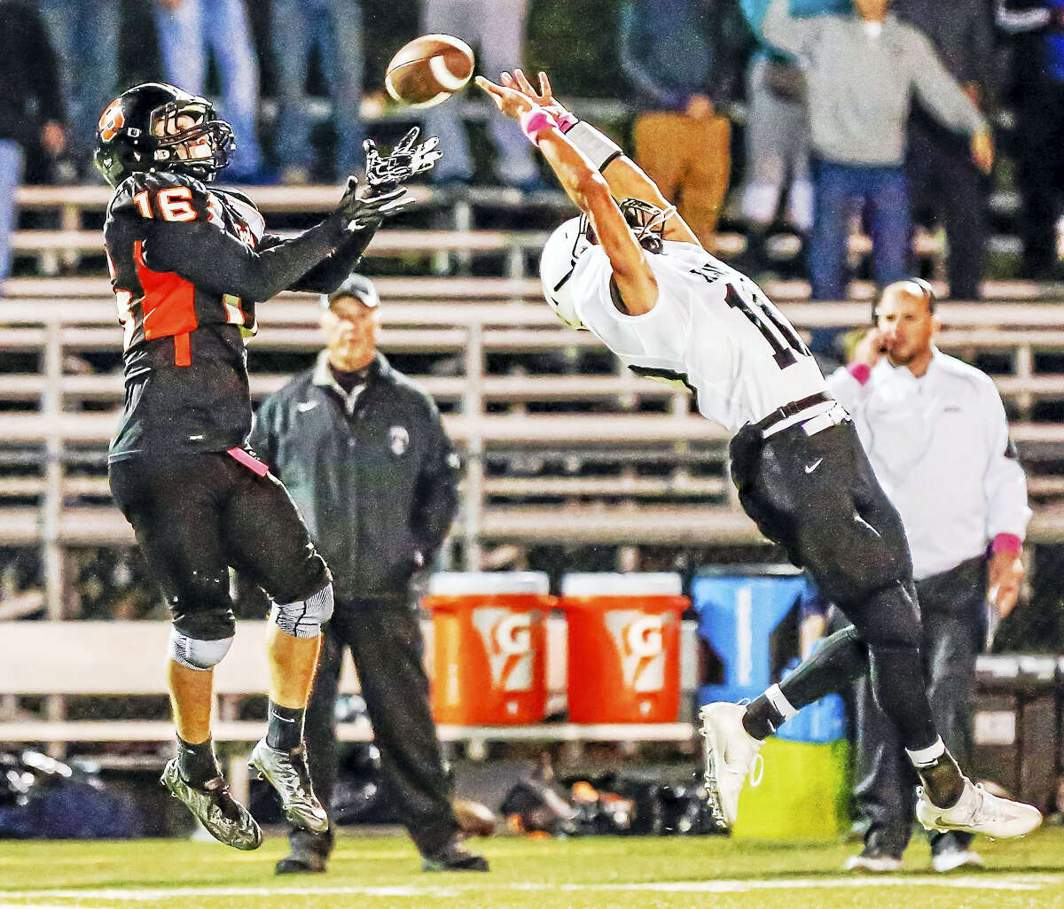 Shelton receiver Anthoony Shiavo(16) completes a pass of the reach of Xaveri Owen Gonzalez(10) to tie the score at 14 during the 2nd quarter during the SCC Tier 1 game Saturday night.-John Vanacore/New Haven register