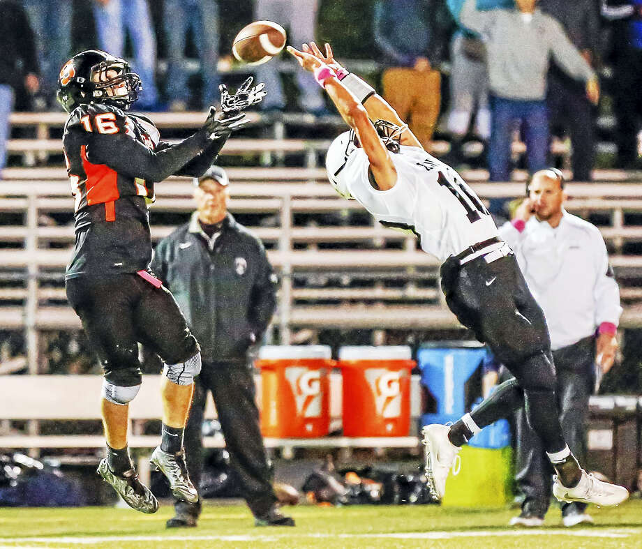 Shelton receiver Anthoony Shiavo(16) completes a pass of the  reach of Xaveri Owen Gonzalez(10) to tie the score at 14 during the 2nd quarter during the SCC Tier 1 game Saturday night.-John Vanacore/New Haven register Photo: Journal Register Co. / John Vanacore/New Haven Register`