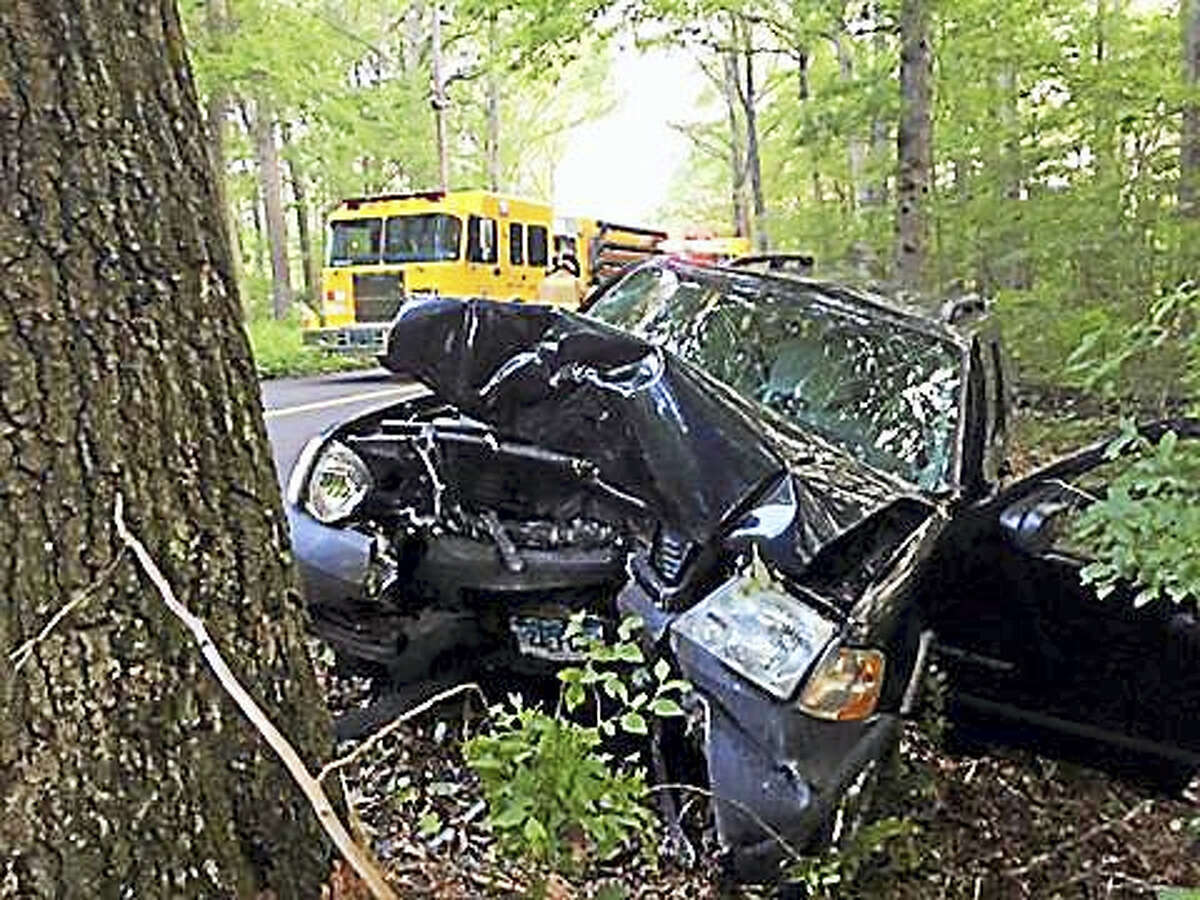 Haddam Volunteer Fire Company crews removed a driver from a car after it smashed into a tree Saturday on Parker Hill Road.