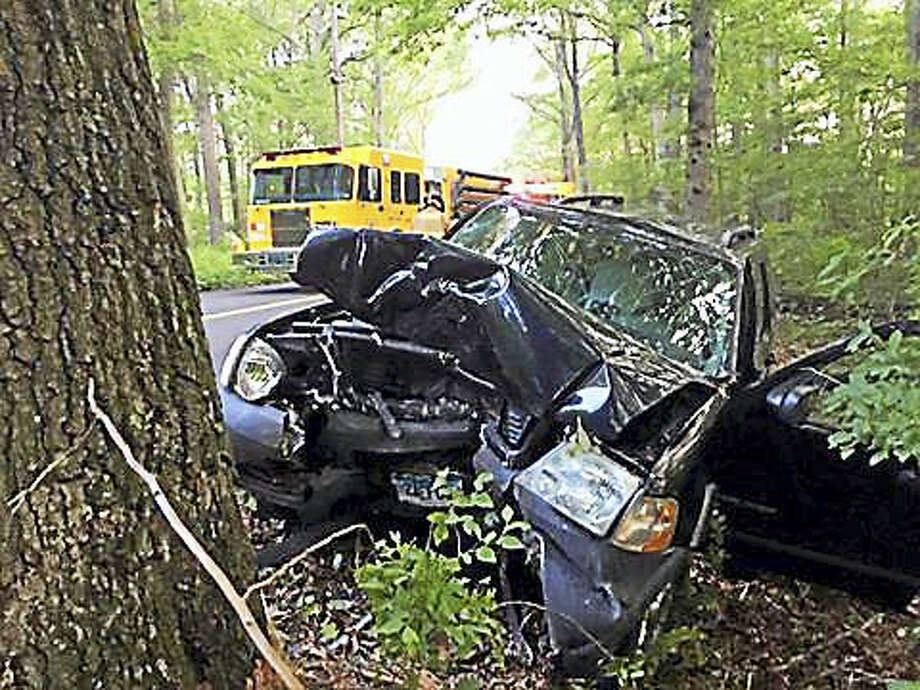 Haddam Volunteer Fire Company crews removed a driver from a car after it smashed into a tree Saturday on Parker Hill Road. Photo: Contributed Photo