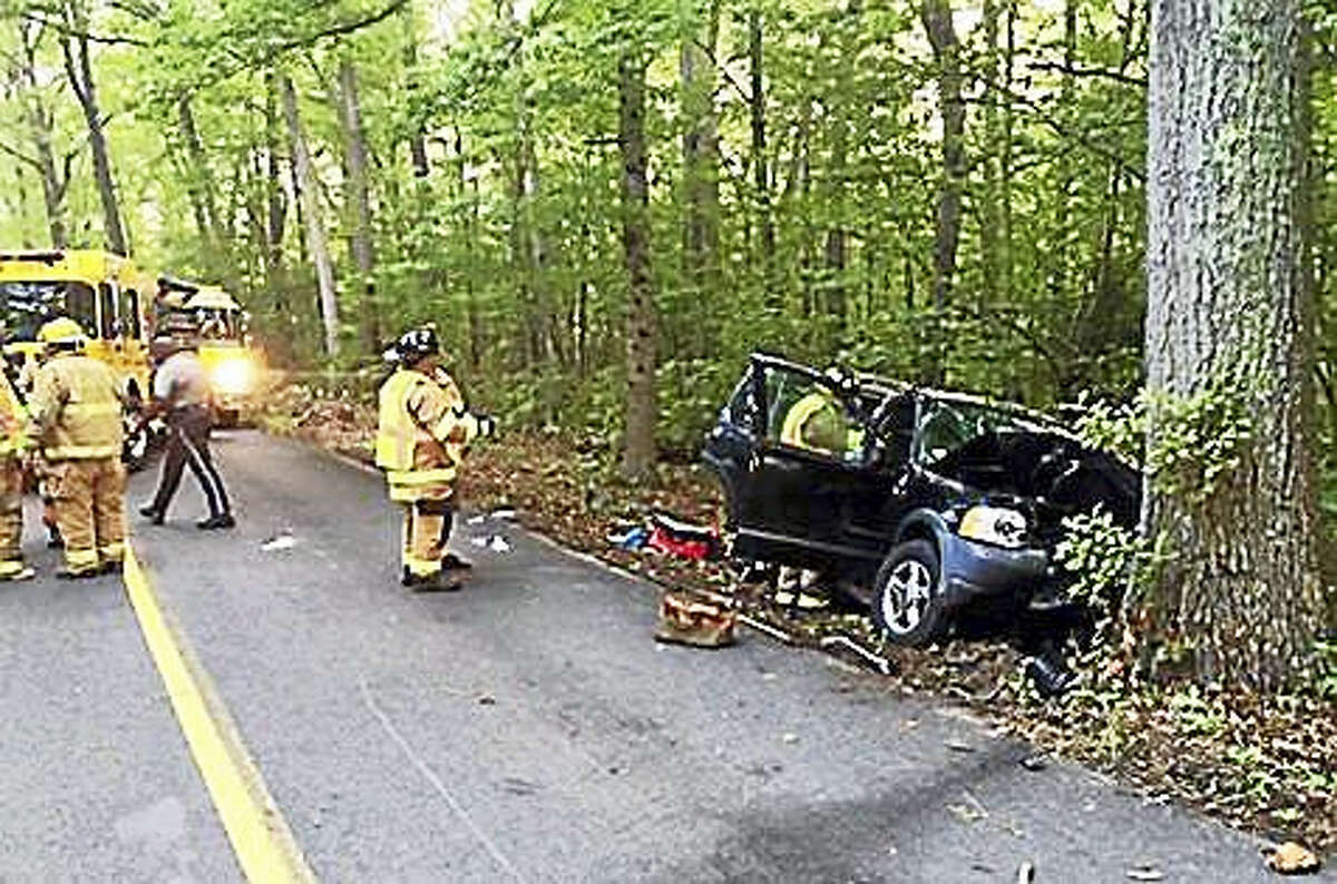 Firefighters help a driver who was seriously injured when she lost control of her vehicle Saturday.
