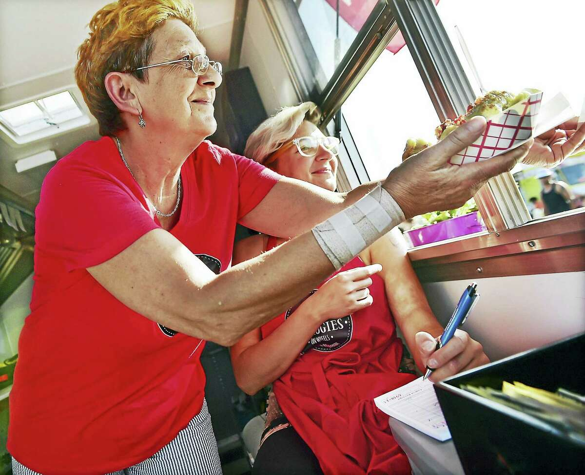 Derby resident Magda Nogas takes orders while her aunt Halina Nogas serves pierogi last year from their food truck, Pierogi on Wheels.