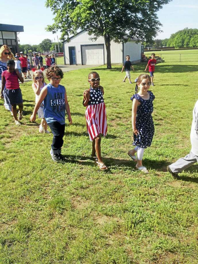 The prekindergarten through second-graders shared their newly learned knowledge about the flag. Photo: Jeff Mill — The Middletown Press
