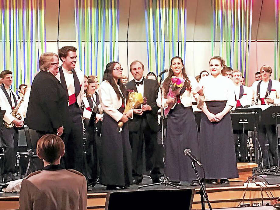 Lisa Larsen and Dean Coutsouridis join students on stage at their final band and chorus concert before the Coginchaug Regional High School veteran music teachers retire. Photo: Courtesy Patti Holden
