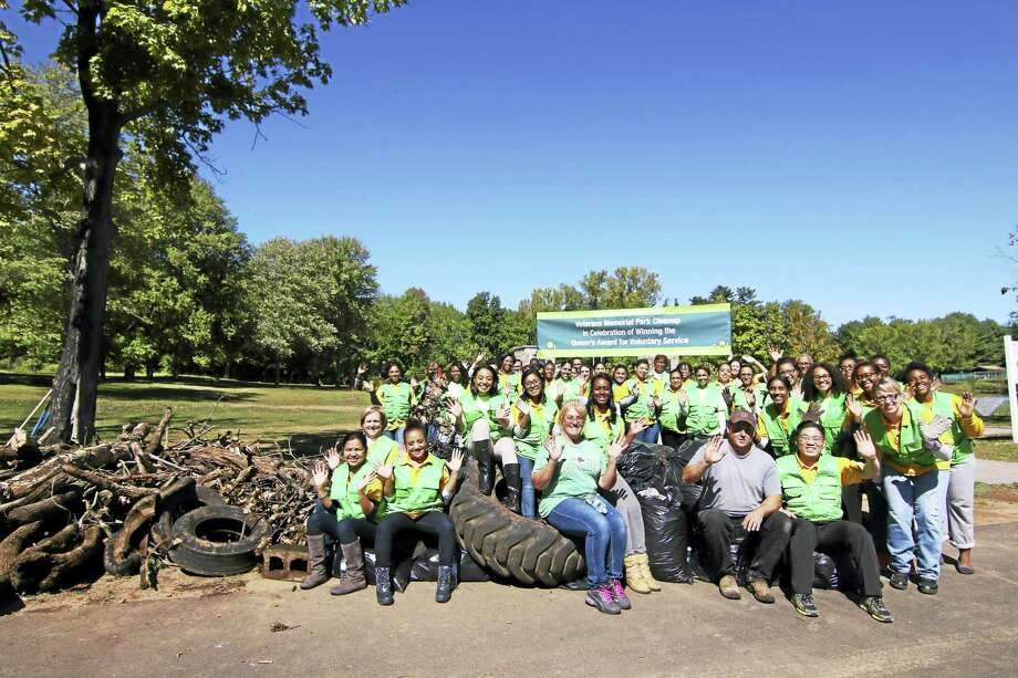 Over 50 volunteers from the World Mission Society Church of God held an environmental cleanup at Veterans Memorial Park and the Coginchaug River in Middletown on East Coast Volunteer Service Day Sept. 25. Photo: Contributed Photo
