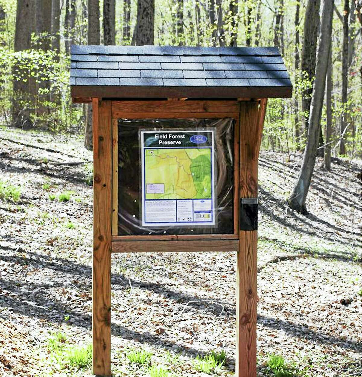 A kiosk at the blue-blazed hiking trail through Field Forest in Durham.