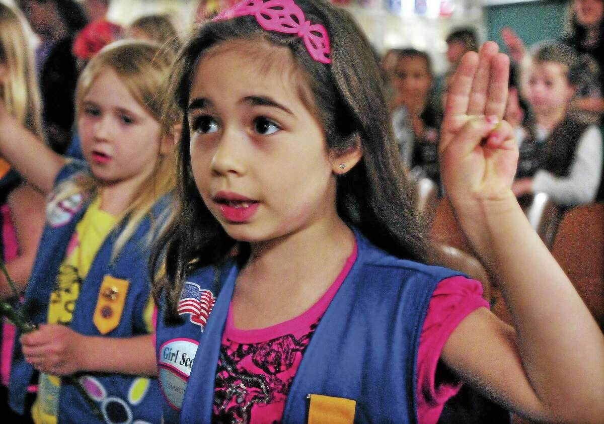 Daisy scout members of Troop 61108 say the Girl Scout Promise following a ceremony at Snow School in Middletown.