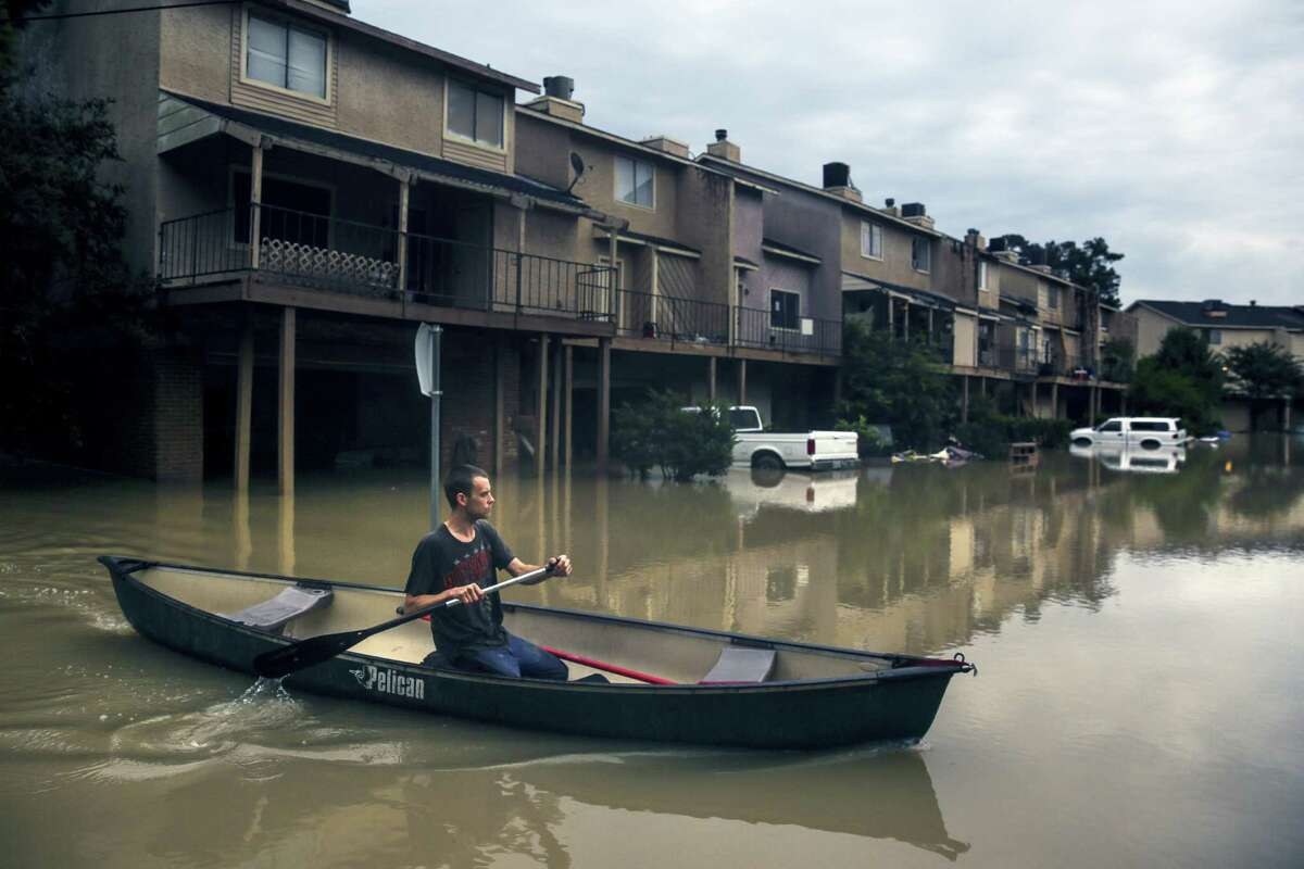 Chance Morgan canoes past flooded townhouses in the Forest Cove neighborhood as he tries to get to his home Thursday, June 2, 2016 near Kingwood, Texas. Parts of Texas have been inundated with rain in the last week, and more than half of the state is under flood watches or warnings, including the counties near Fort Hood. At least six people died in floods last week in Central and Southeast Texas.