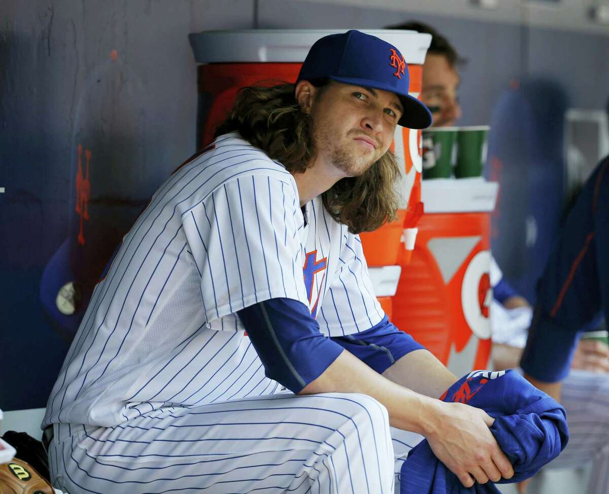 New York Mets starting pitcher Jacob deGrom reacts in the dugout after allowing a game-tying, solo home run to Chicago White Sox Todd Frazier during the seventh inning Wednesday in New York.
