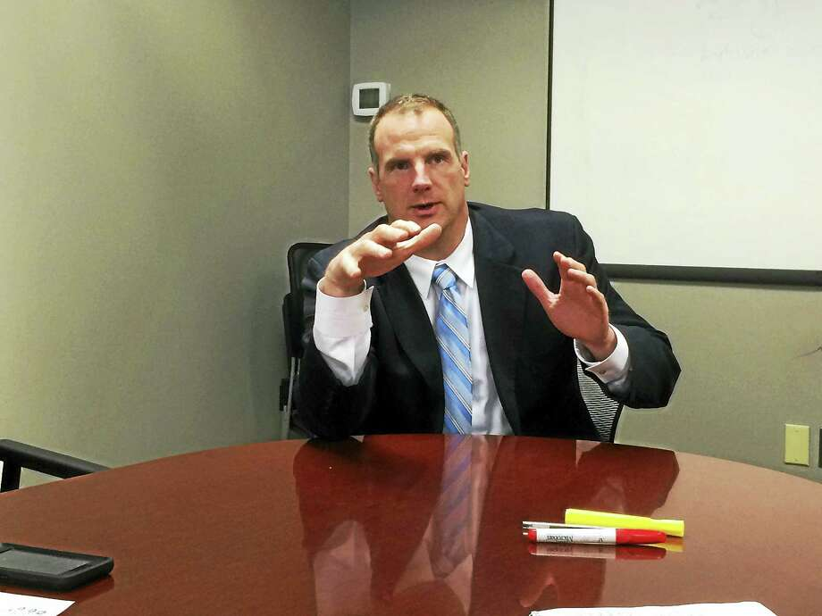 Joe Delong, executive director of the Connecticut Conference of Municipalities, is seen during a recent editorial board meeting with Digital First Media staff. Chris Powell argues that CCM mistakes Connecticut's impoverished cities for a problem of tax policy. Photo: Register Citizen File Photo