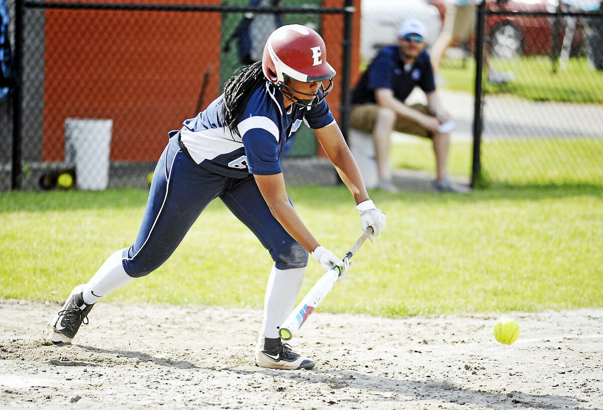 Jimmy Zanor - The Middletown PressMiddletown freshman Dominque Highsmith gets the sacrifice bunt down against Wilton on Wednesday at Hank Hiller Field.