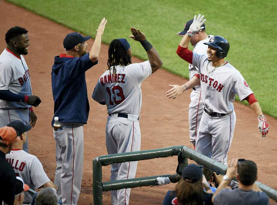 Boston's Mookie Betts, right, celebrates his home run with Hanley Ramirez (13) during the second inning against the Baltimore Orioles, Wednesday in Baltimore. Photo: NICK WASS — THE ASSOCIATED PRESS  / FR67404 AP