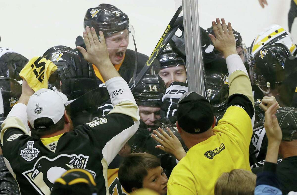 Pittsburgh Penguins' Conor Sheary is mobbed by teammates after his goal against the San Jose Sharks during overtime in Game 2 of the NHL hockey Stanley Cup Finals on Wednesday in Pittsburgh. The Penguins won 2-1 to take a 2-0 series lead.