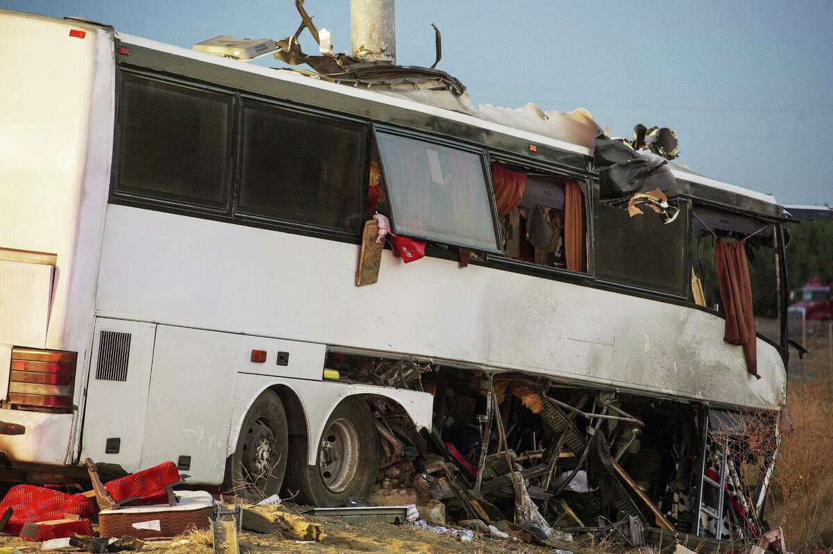The wreckage of a charter bus sits on northbound Highway 99 between Atwater and Livingston, Calif., Tuesday, Aug. 2, 2016. The bus veered off the central California freeway before dawn Tuesday and struck a pole that sliced the vehicle nearly in half, authorities said.