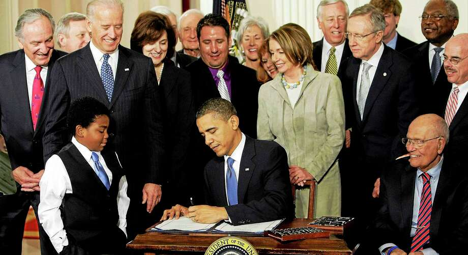 In this March 23, 2010, photo, President Barack Obama signs the Affordable Care Act in the East Room of the White House in Washington. Photo: J. Scott Applewhite — The Associated Press File Photo  / AP