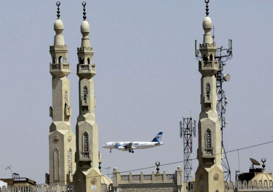 An EgyptAir plane flies past minarets of a mosque as it approaches Cairo International Airport, in Cairo, Egypt. A French company says Wednesday, June 2, 2016 its equipment aboard a French naval ship has detected signals from one of the black box flight recorders on the EgyptAir flight that crashed into the Mediterranean Sea last month. Photo: AP Photo — Amr Nabil, File / Copyright 2016 The Associated Press. All rights reserved. This material may not be published, broadcast, rewritten or redistribu