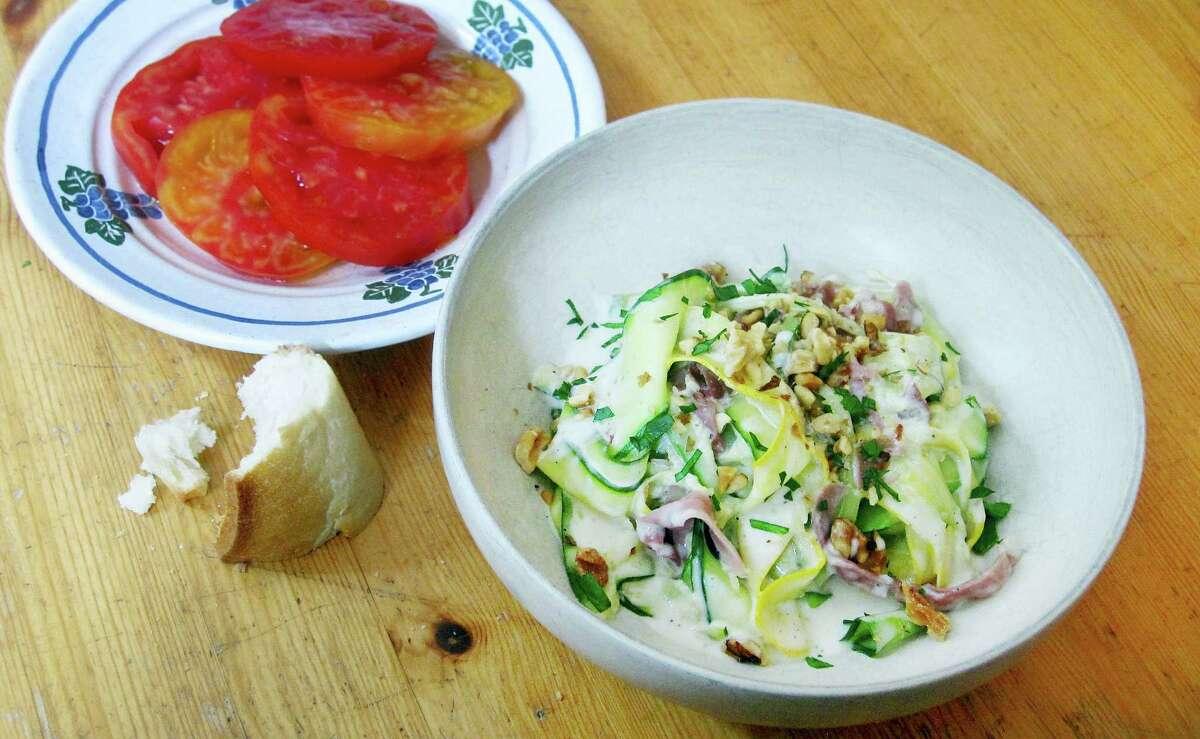 """Zucchini ribbon """"pasta"""" in lemon cream sauce."""