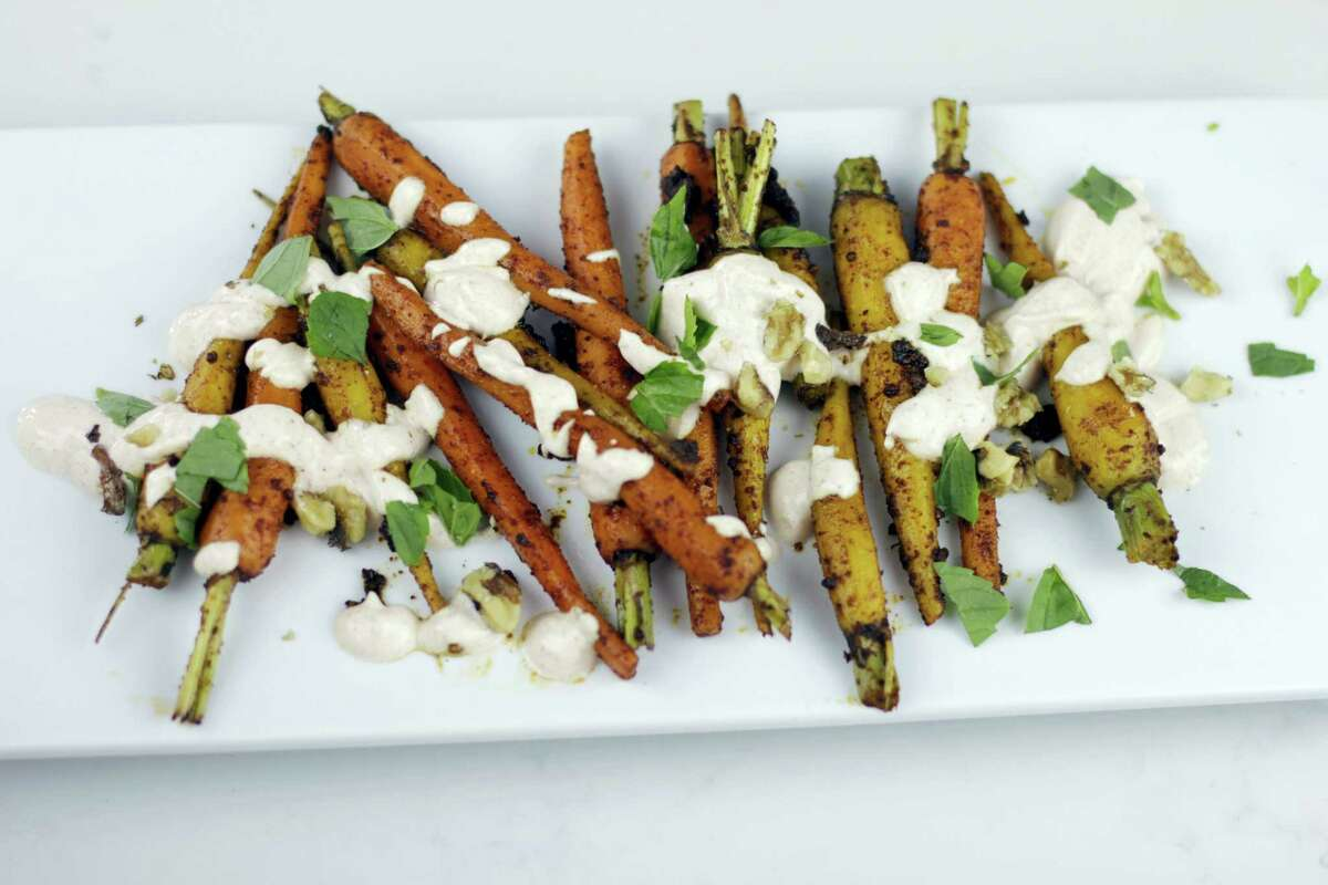 Moroccan spiced carrots with yogurt sauce.