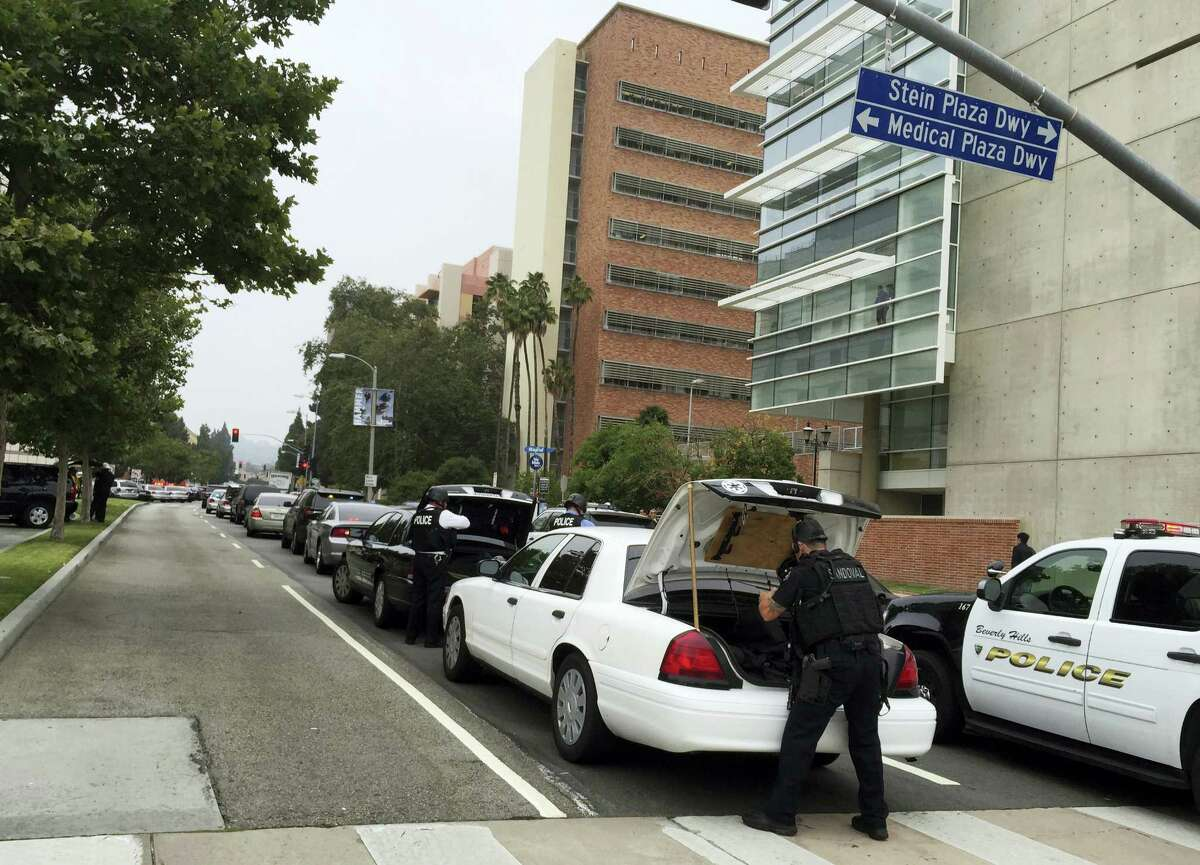 Police work at the scene of shootings at the University of California, Los Angeles, Wednesday, June 1, 2016, in Los Angeles.