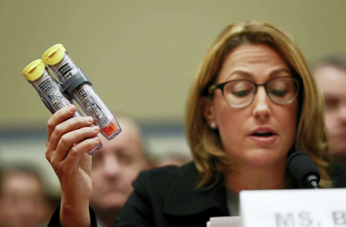 Mylan CEO Heather Bresch holds up EpiPens while testifying on Capitol Hill in Washington, before the House Oversight Committee hearing on EpiPen price increases.