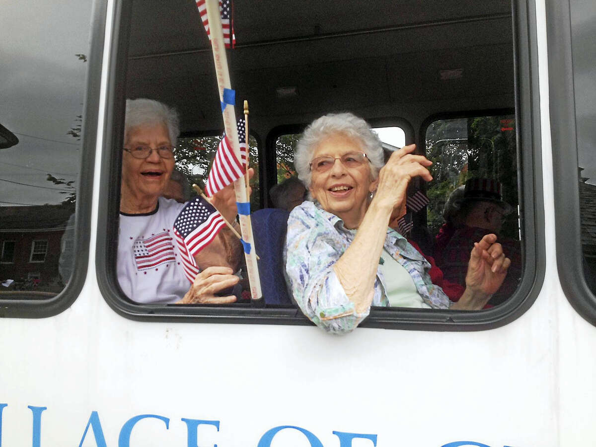 For the town's Memorial Day parade Monday, Covenant Village residents sat in a motor coach parked on South Park Street, overlooking the World War I Memorial Green and the gazebo in the center of the park.