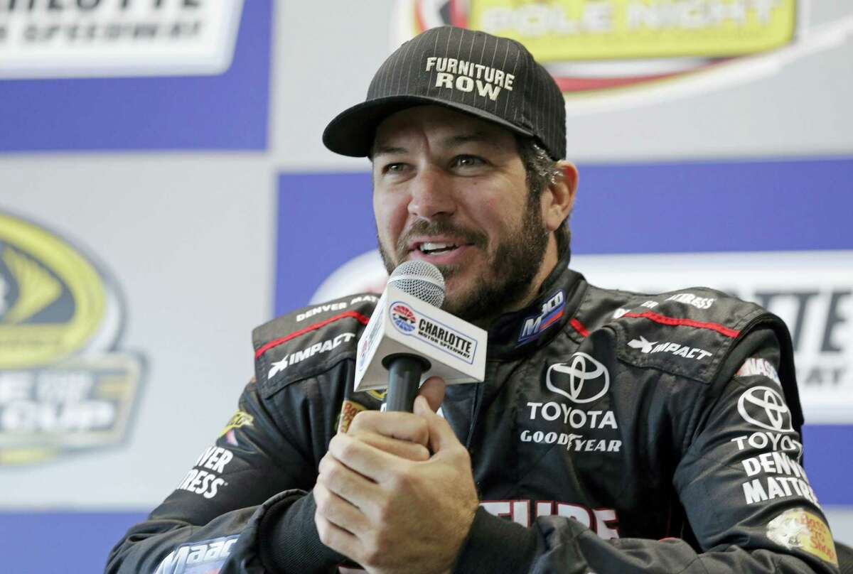 Martin Truex Jr. answers a question during a news conference at Charlotte Motor Speedway in Charlotte, N.C., on Thursday.