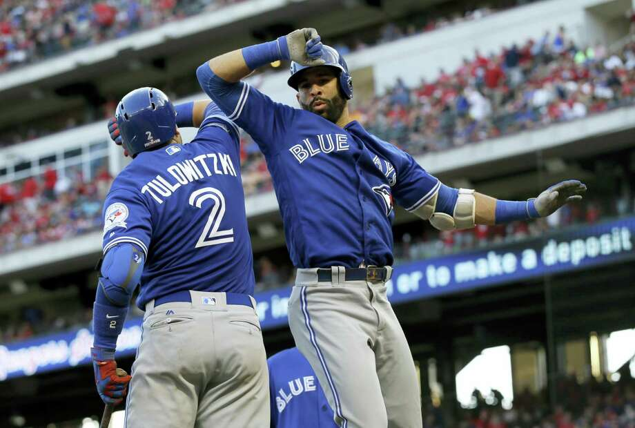 The Blue Jays' Troy Tulowitzki (2) and Jose Bautista celebrate Bautista's three-run home run against the Rangers on Thursday. Photo: LM Otero — The Associated Press  / Copyright 2016 The Associated Press. All rights reserved.