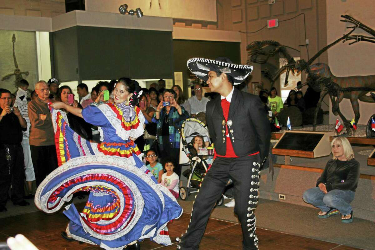 A Fiesta Latina crowd enjoys traditional music and dance.