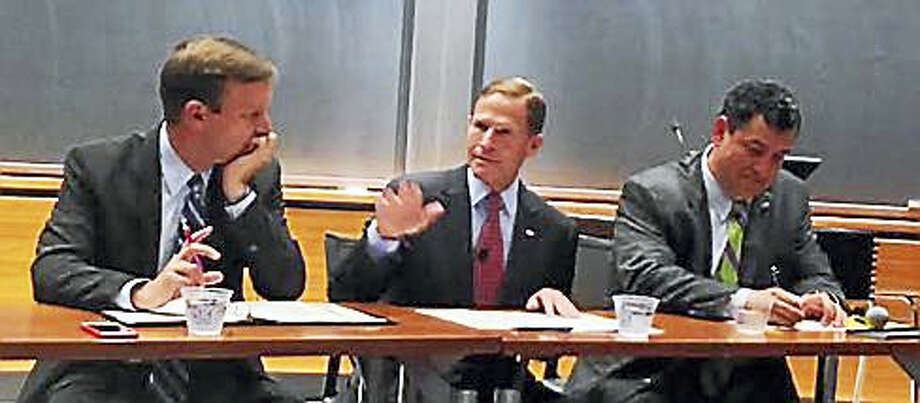 From left, U.S. Sens. Chris Murphy and Richard Blumenthal with Bryan Garcia, president and CEO of the Connecticut Green Bank Photo: Jack Kramer/ctnewsjunkie