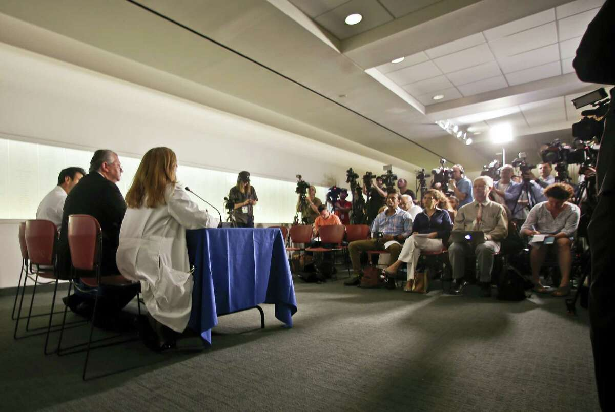 Dr. Abdulla Al-Khan, director of the Center for Abnormal Placentation, left, Dr. Ihor Sawczuk, president of the Hackensack University Medical Center, second from left, and Dr. Julia Piwoz, chief of the Pediatric Infections Diseases at the Joseph M. Sanzari Children's Hospital, third from left speak during a news conference at the Hackensack University Medical Center, Wednesday, June 1, 2016, in Hackensack, N.J. Doctors say a baby born to a mother with the Zika virus appears to be affected by the disease. Officials at Hackensack University Medical Center say the 31-year-old woman from Honduras delivered the baby girl through a cesarean section on Tuesday.