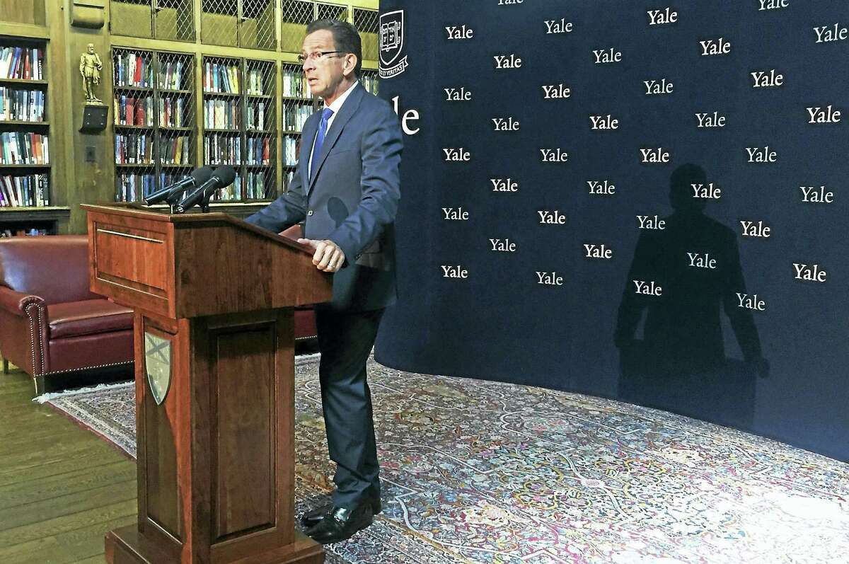Connecticut Gov. Dannel Malloy announces a new, statewide plan to address the state's opioid crisis during a press conference at the Yale School of Medicine on Thursday, Oct.6, in New Haven. Esteban L. Hernandez New Haven Register