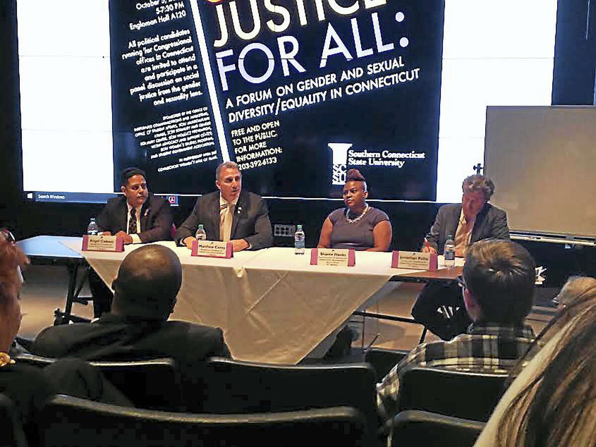 Panelists at a Southern Connecticut State University forum on gender and sexual diversity equality, from left, congressional candidate Angel Cadena, congressional candidate Matthew Corey, Deputy District Director for Congressman Jim Himes Shante Hanks, and congressional candidate Jonathan Pelto.