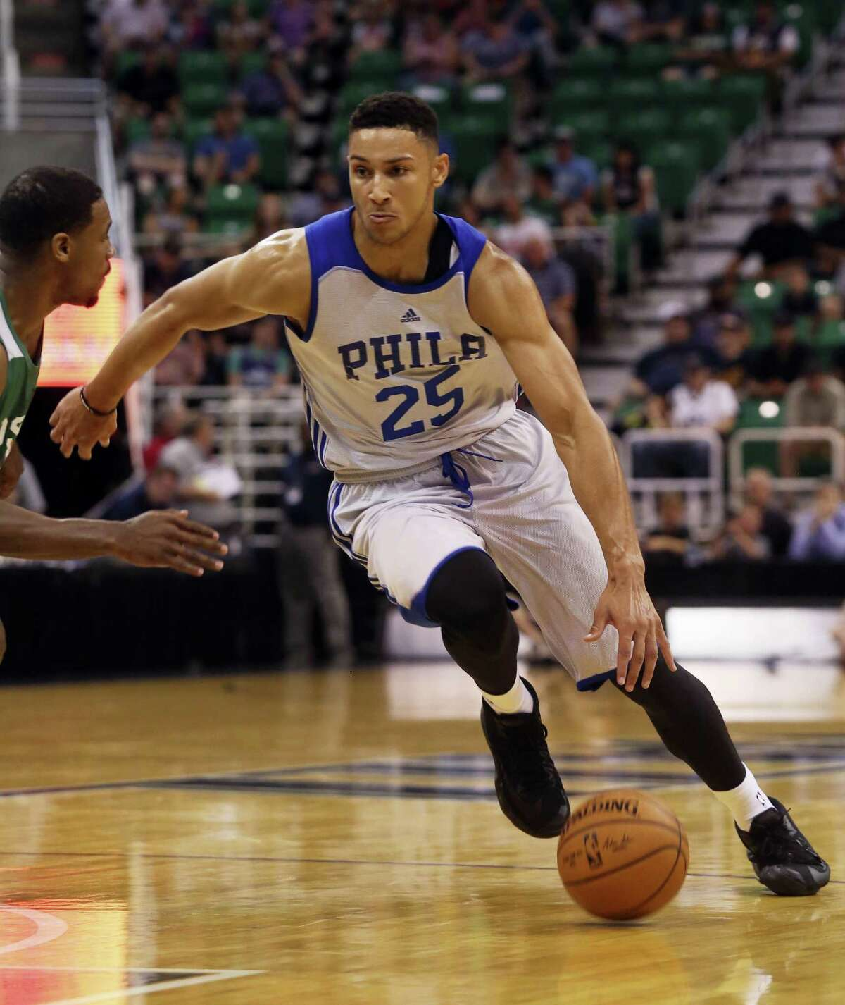 In this July 4, 2016 photo, Philadelphia 76ers' Ben Simmons dribbles downcourt during an NBA Summer League basketball game against the San Antonio Spurs in Salt Lake City. No. 1 overall pick Simmons broke a bone in his right foot on Sept. 30, 2016 during the 76ers' final training camp scrimmage at Stockton University.