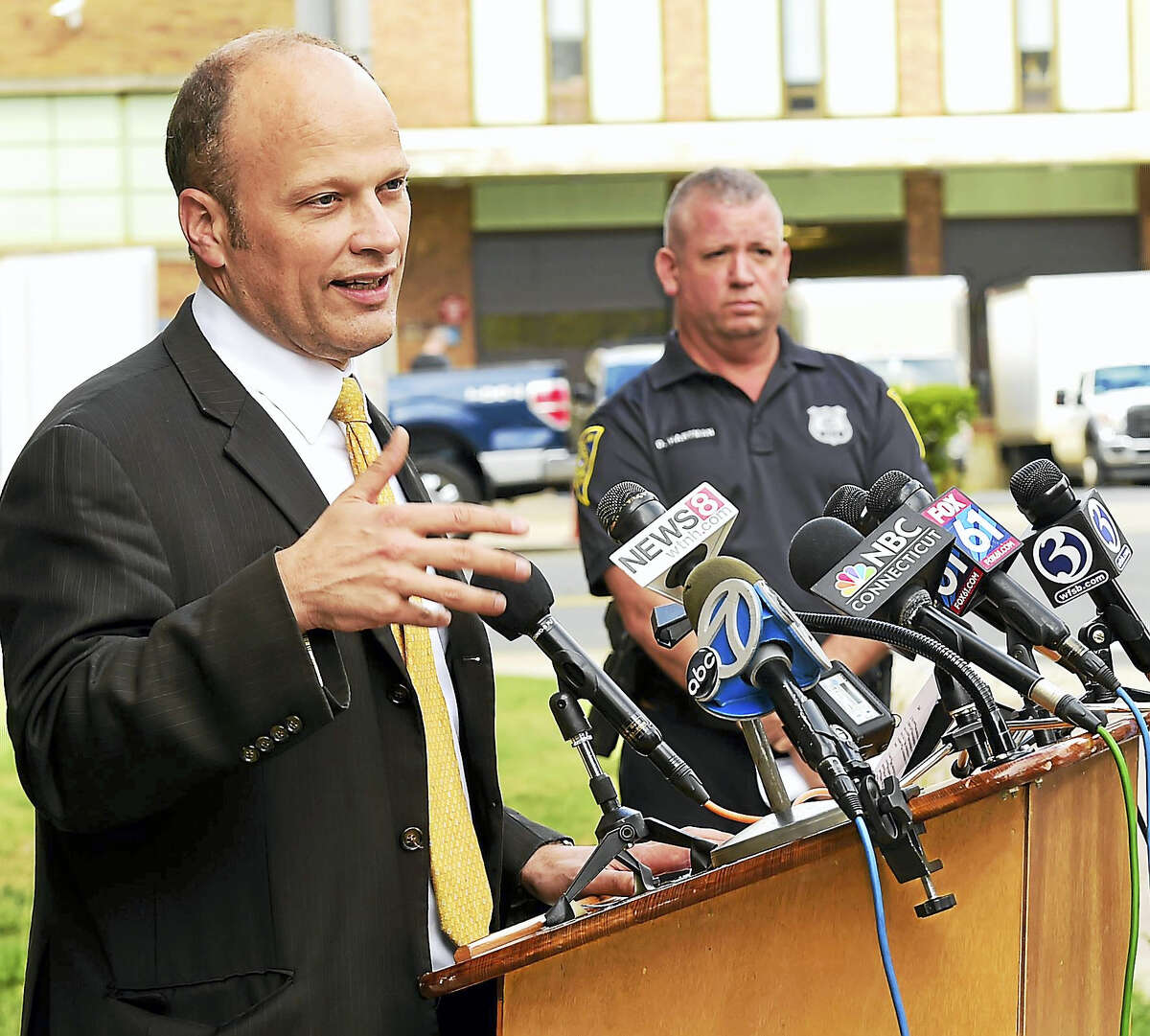 """New Haven Superintendent of Schools Garth Harries, left, speaks during a press conference Tuesday outside the Board of Education office in New Haven to answer questions about the investigation into """"intangible"""" threats to New Haven schools by an Instragram account showing menacing clown photos and messages. At right is New Haven police spokesman Officer David B. Hartman."""