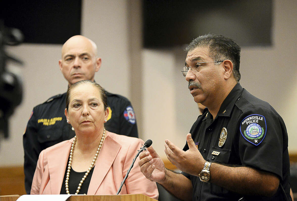Police chief Orlando Rodriguez addresses the media, Tuesday, Oct. 4, 2016, in Brownsville, Texas. The local school district and city officials spoke to the media regarding recent threat-like hoaxes directed at area schools resulting in one student's arrest and a pending investigation. (Jason Hoekema/The Brownsville Herald via AP)
