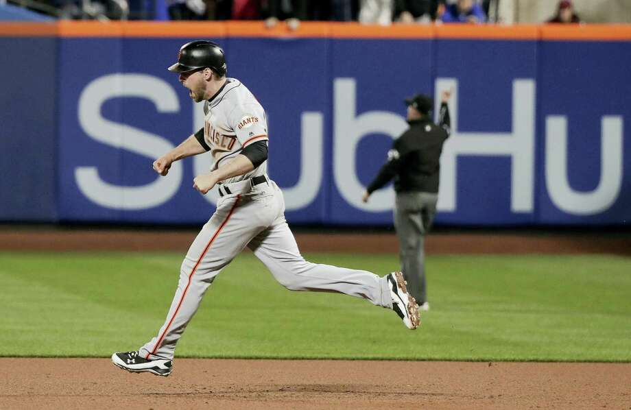 San Francisco'S Conor Gillaspie reacts as he rounds the bases after hitting a three-run home run against the New York Mets during the ninth inning of the National League wildcard baseball game Wednesday in New York. (AP Photo/Julie Jacobson) Photo: JULIE JACOBSEN — THE ASSOCIATED PRESS  / Copyright 2016 The Associated Press. All rights reserved.
