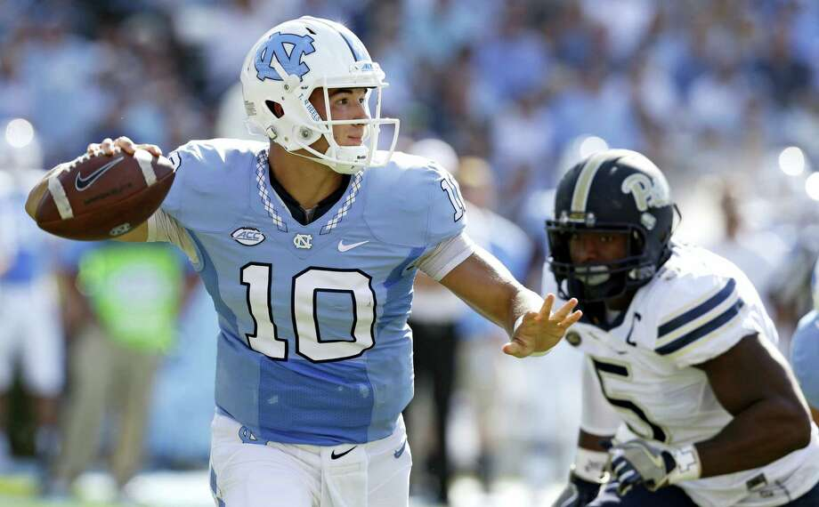 In this Sept. 24, 2016 photo, North Carolina quarterback Mitch Trubisky (10) throws a pass as Pittsburgh's Ejuan Price (5) rushes during the first half of an NCAA college football game in Chapel Hill, N.C. UNC's takes on Florida State in an ACC matchup on Saturday. Photo: AP Photo/Gerry Broome, File  / Copyright 2016 The Associated Press. All rights reserved.