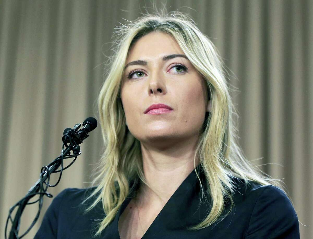 In this Monday March 7, 2016 photo, tennis star Maria Sharapova speaks about her failed drug test at the Australia Open during a news conference in Los Angeles. The highest court in sports has cut Maria Sharapova's two-year doping ban to 15 months.