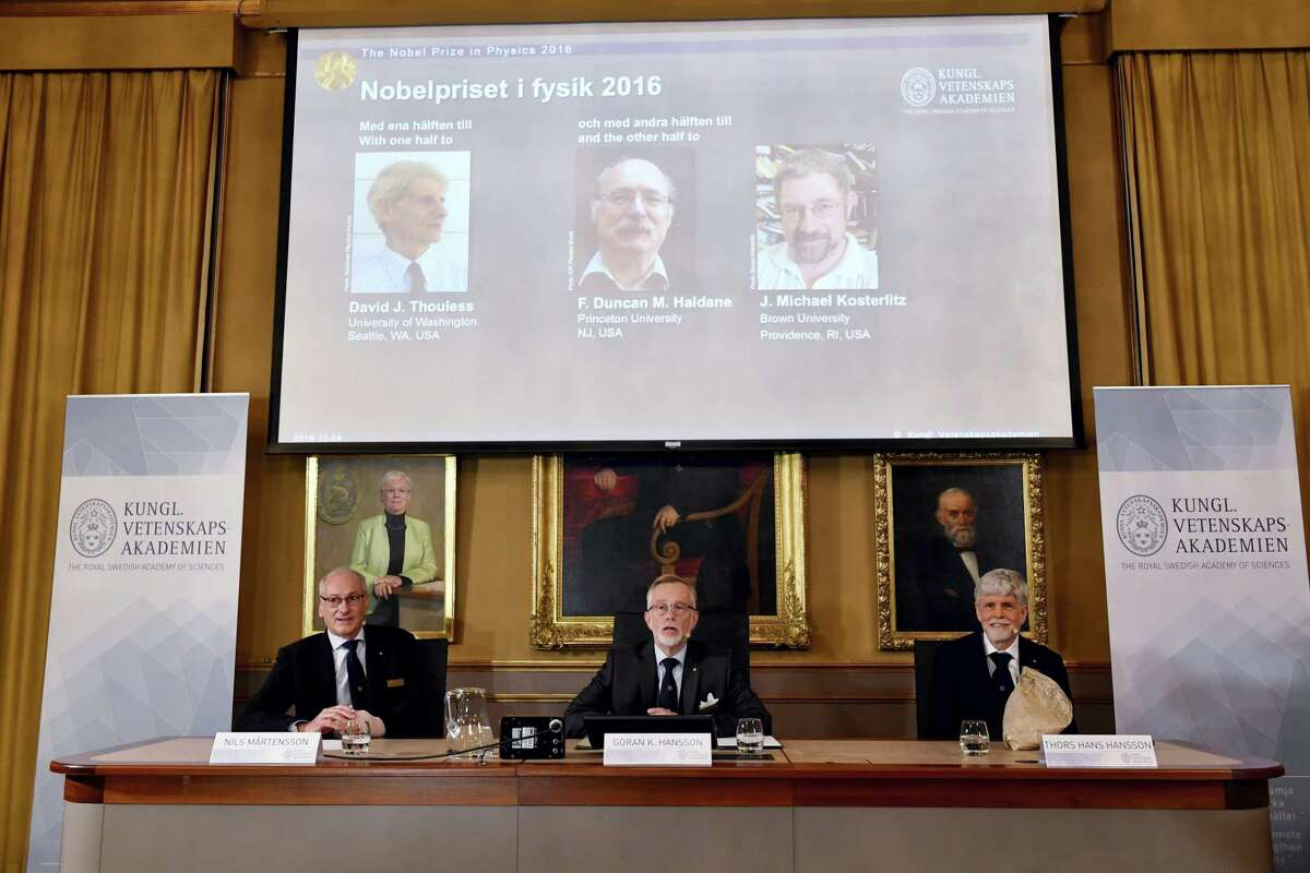 The Royal Academy of Sciences members, from left, Professor Nils Martensson, Professor Goran K Hansson and Professor Thomas Hans Hansson reveal the winners of the Nobel Prize in physics, at the Royal Swedish Academy of Sciences, in Stockholm, Sweden, Tuesday, Oct. 4, 2016. David Thouless, Duncan Haldane and Michael Kosterlitz have won the Nobel physics prize. Nobel jury praises physics winners for 'discoveries of topological phase transitions and topological phases of matter'.