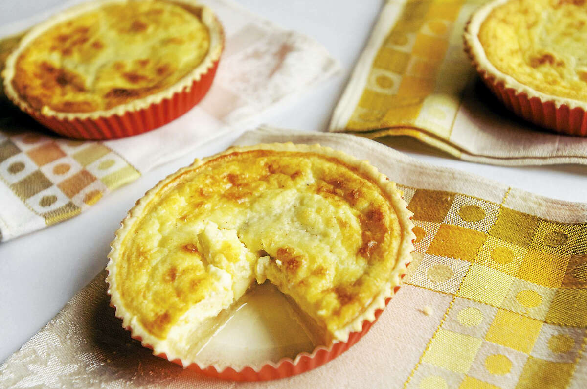 The Fly Creek Cider Mill Cookbook's apple-cheddar quiche, a creative and tasty recipe.